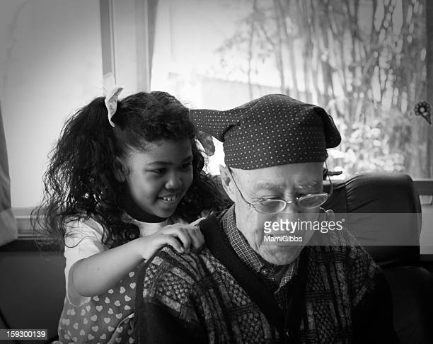 a close grandfather and granddauther. - massage parlour stock photos and pictures