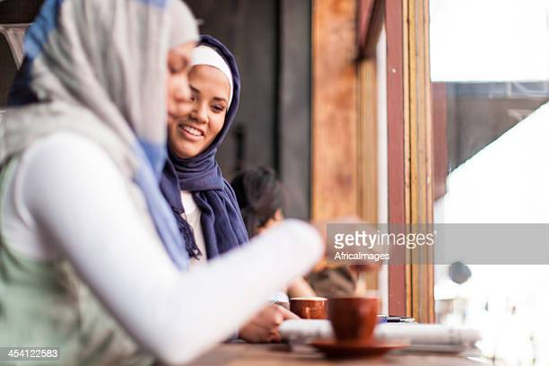 Close muslim friends catching up with some coffee.