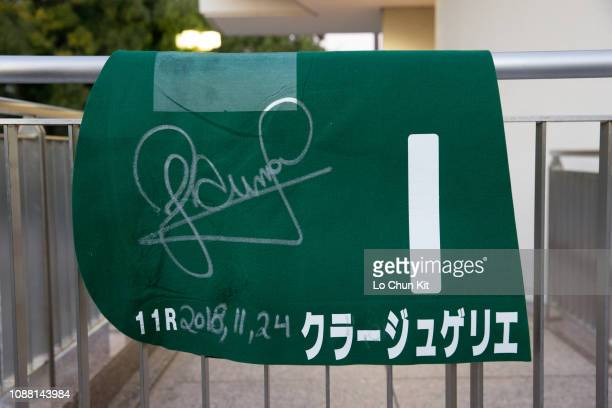Close of Courageux Guerrier's saddle cloth with jockey Joao Moreira autograph after winning Race 11 The Radio Nikkei Hai Kyoto Nisai Stakes at Kyoto...