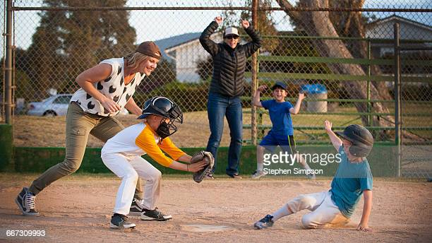 close play at home plate, runner sliding in - home base sports stock pictures, royalty-free photos & images