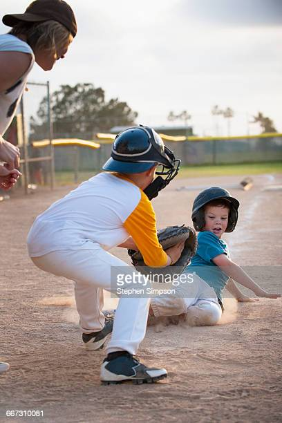 close play at home plate, runner sliding in