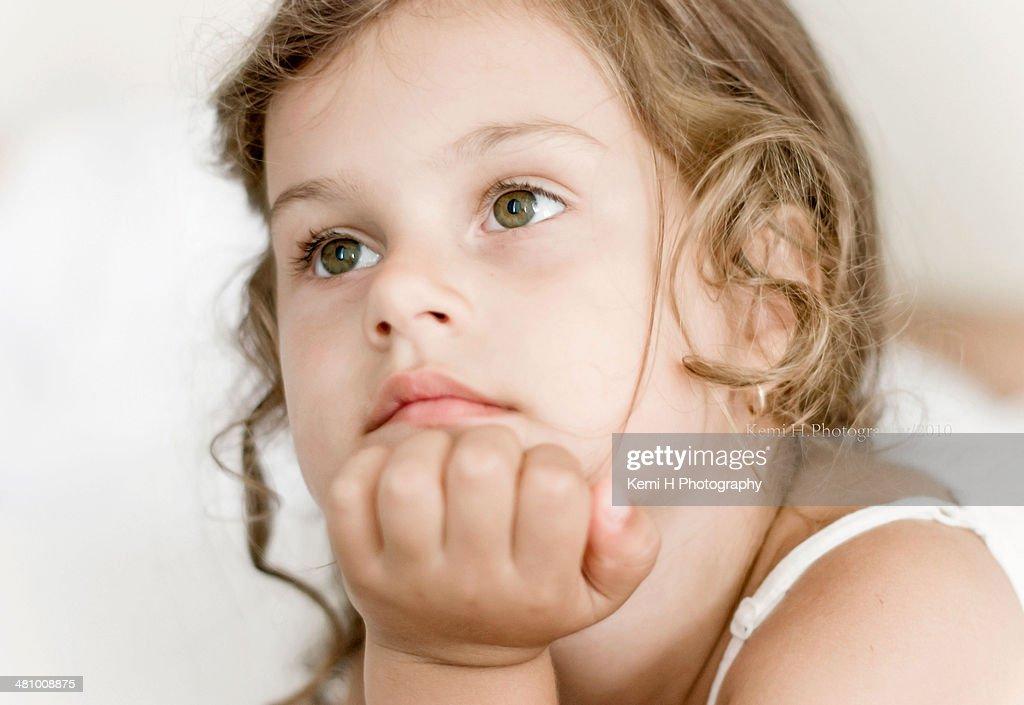 close portrait little thoughtful girl : Stock Photo