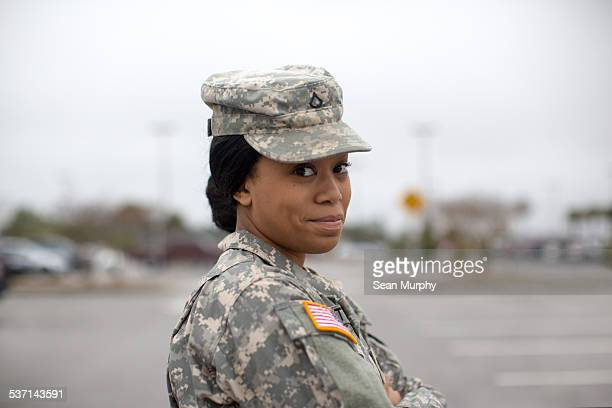 close portrait of female army soldier - army soldier stock pictures, royalty-free photos & images