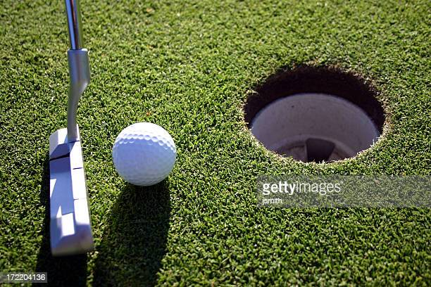 close putt - birdie golf stock photos and pictures