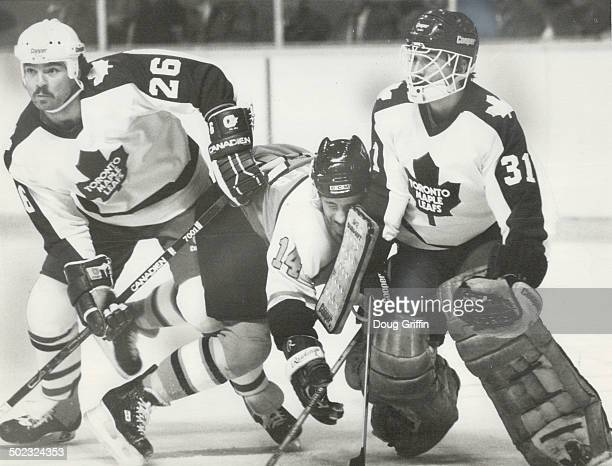Close quarters Ron Sutter of the Philadelphia Flyers finds his situation a little tight early in last night's National Hockey League game at the...
