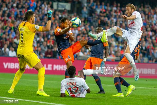 September 25: A close range effort from Renaud Ripart of Nimes appears to strike the hand of Hilton of Montpellier and fall into goalkeepers Geronimo...