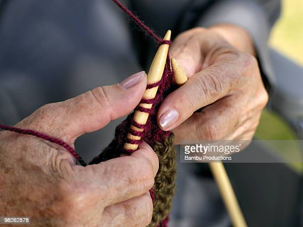 close shot of elderly woman knitting  - newhealth stock photos and pictures