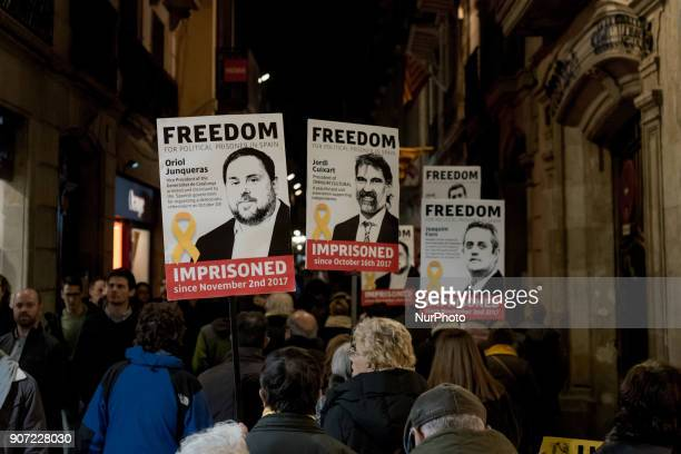 Close to Las Ramblas of Barcelona Catalonia Spain people march showing posters of imprisoned politicians and pro independentist leaders on 19 January...