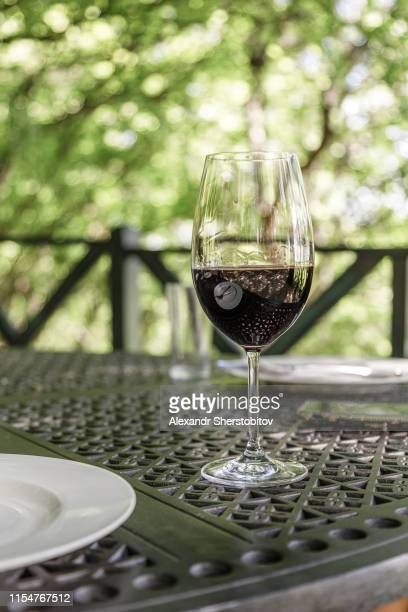 close u view of glass of red wine - コーカサス ストックフォトと画像