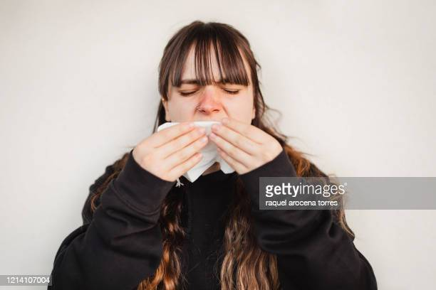 close uo view of young woman suffering spring allergy - mucus stock pictures, royalty-free photos & images