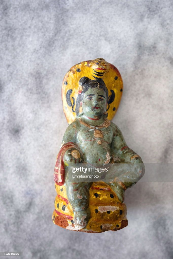 Close up a green ceramic staue on gray marble tabletop. : Stock Photo