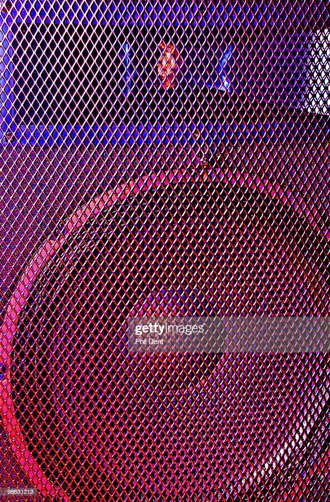 Close up a PA speaker behind a speaker grille, showing woofer and tweeter, on 25th March 2010 in United Kingdom.