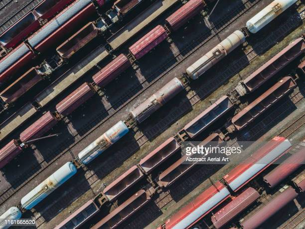 close up aerial shot of train locomotives, munich, germany - 貨物列車 ストックフォトと画像