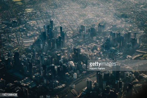 close up aerial view of foggy melbourne city - docklands stadium melbourne stock pictures, royalty-free photos & images