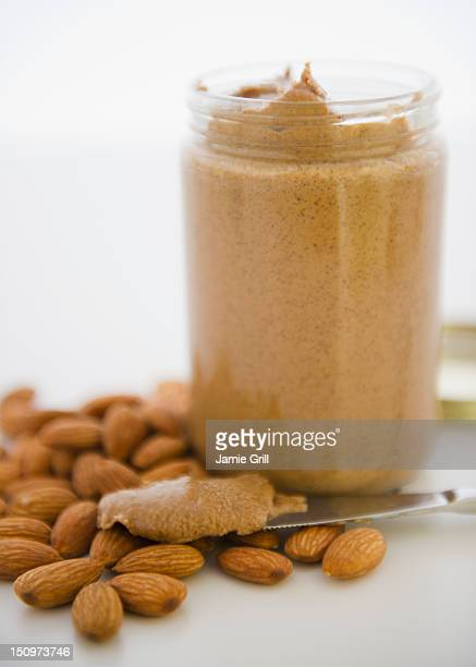 Close up almond butter and almonds
