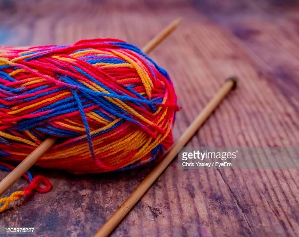 close up and selective focus on a multi coloured ball of knitting yarn - needlecraft stock pictures, royalty-free photos & images