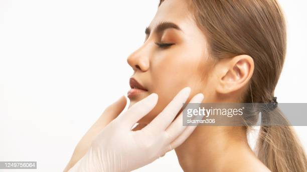 close up asian asian girl beauty face aesthetic with filler lip by syringe white background beauty and surgery lip fillers concept - estetista foto e immagini stock