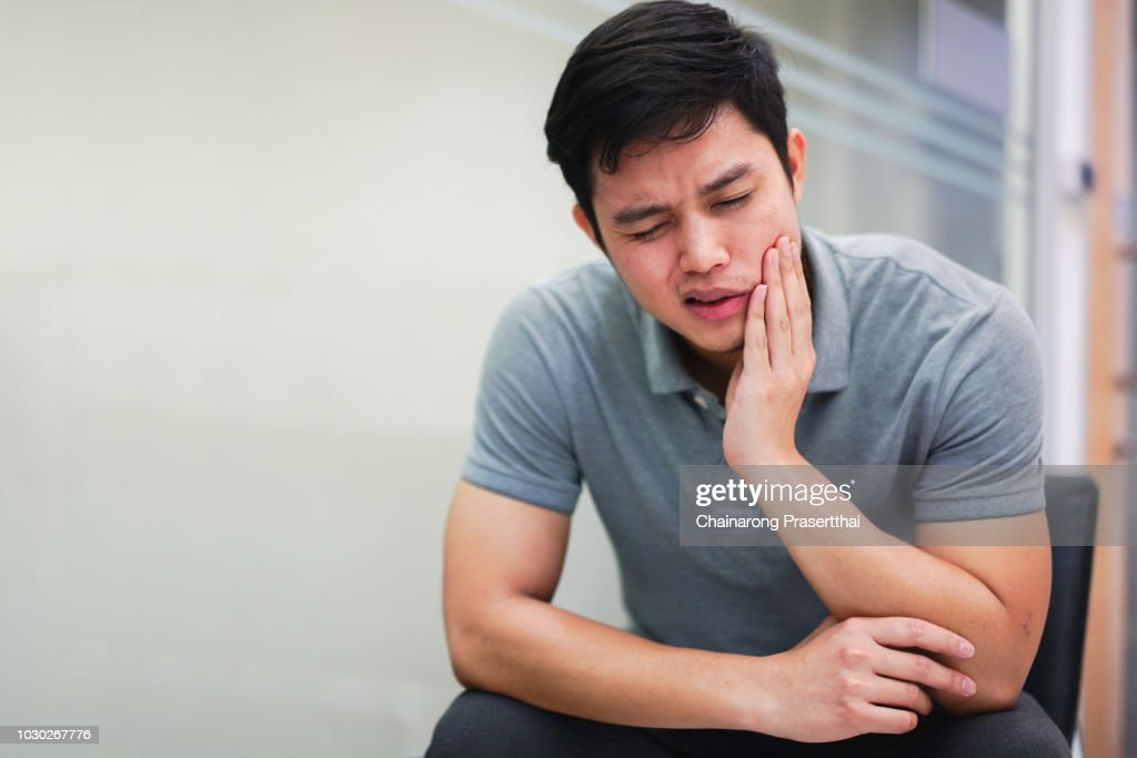 close up asian middle aged man feeling hurt from toothache symptom , unhealthy life concept : Stock Photo