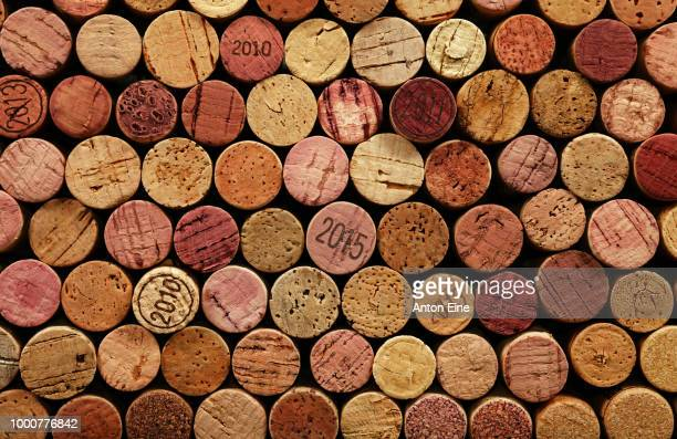 close up background of used wine corks - large group of objects stock pictures, royalty-free photos & images