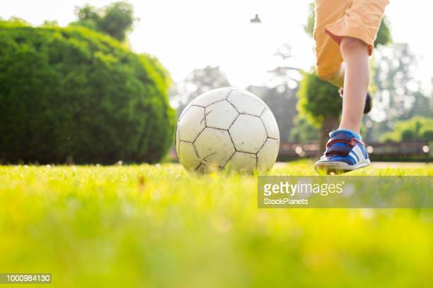 close up ball lying on the grass - passing sport stock pictures, royalty-free photos & images
