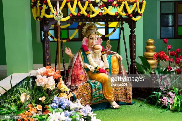 close up beautiful hindu god ganesha statue god of success - ganesh chaturthi stock photos and pictures