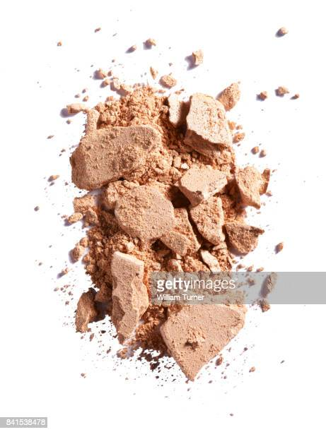 A close up beauty image of a smashed or broken powder make up compact