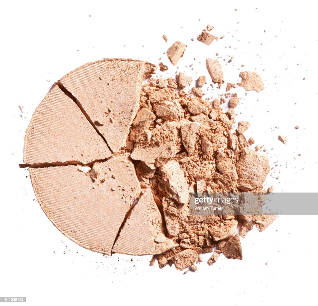 A close up beauty image of a smashed or broken powder make up compact : Stock Photo