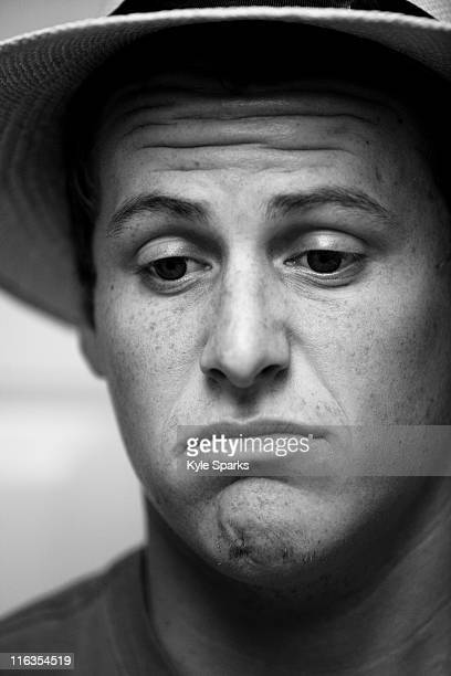 Close up black and white headshot of a young man frowning while wearing a hat in Camarillo, California.