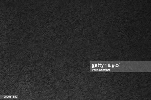 close up black leather and texture background. - leather stock pictures, royalty-free photos & images