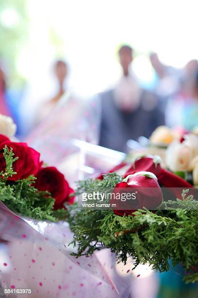 Close up bouquet with couple in background
