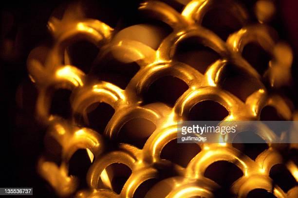 Close up bronze metallic lantern with lattice pattern