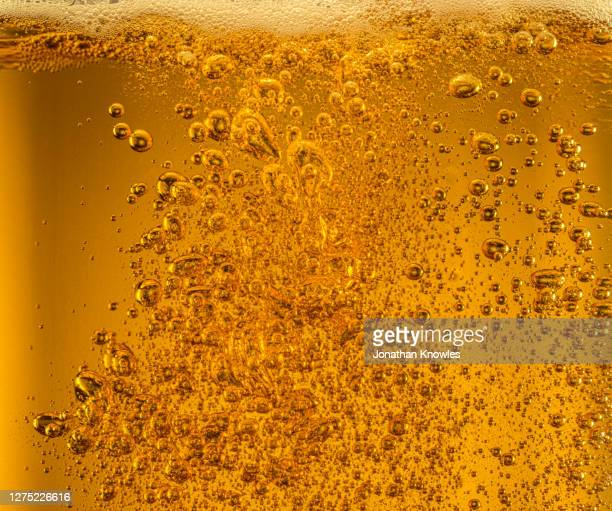 close up bubbles in beer - bubble stock pictures, royalty-free photos & images