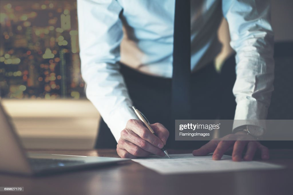 Close up business man signing contract : Stock Photo