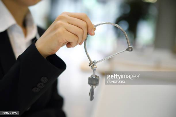 Close up businesswoman holding key ring