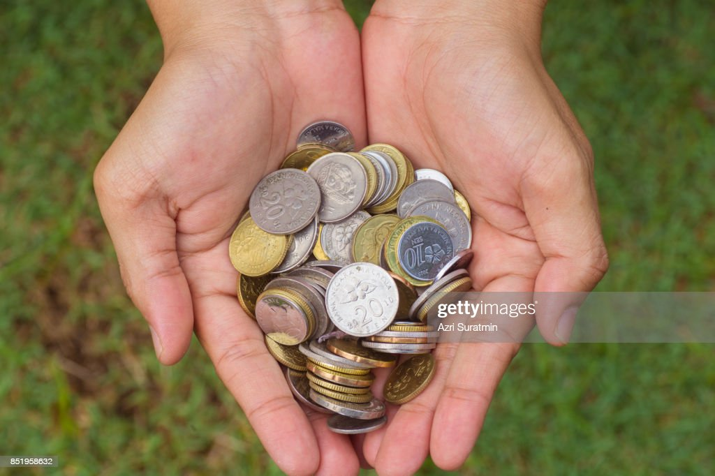 Close up coins in hand : Stock Photo