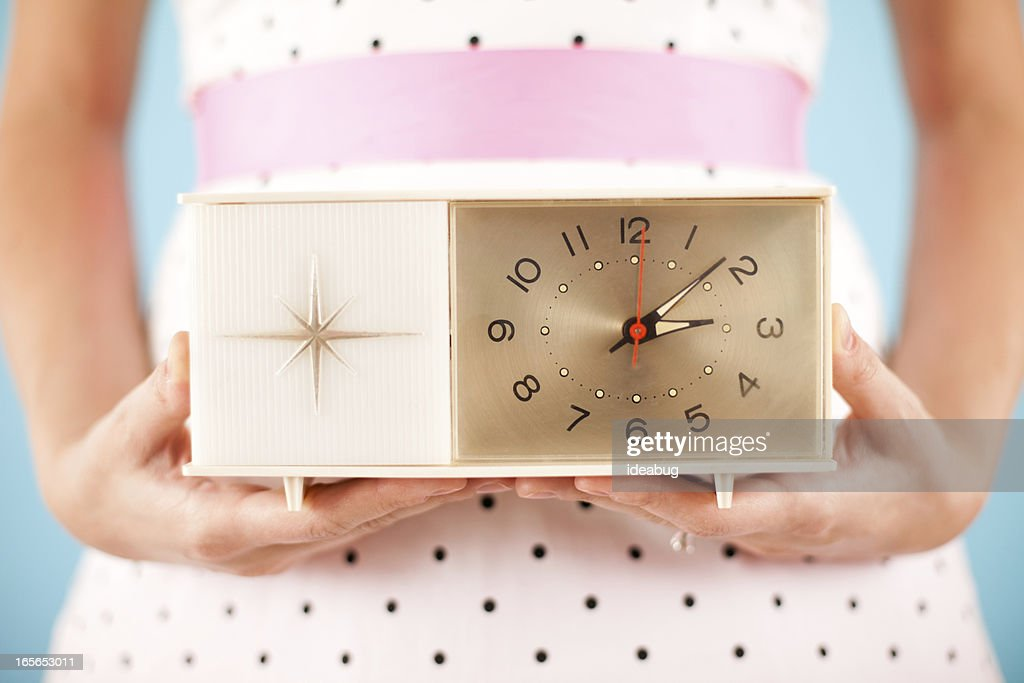 Close Up Color Image of Retro Gal Holding a Clock : Stock Photo