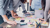 Close up creative designer applaud for job success at meeting table at office.