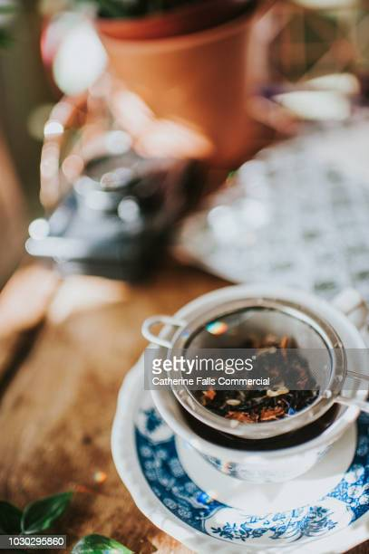 close up cup of tea - colander stock photos and pictures