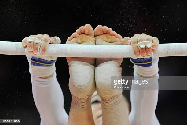 A close up detail of a gymnast's hands and feet on the uneven bars during the Womens Artistic Gymnastics Qualification as part of the 2012 London...