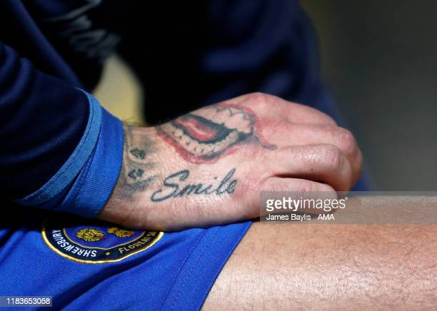 Close up detail of a Joker tattoo on the hand of Jason Cummings of Shrewsbury Town before the FA Cup First Round Replay match between Bradford City...