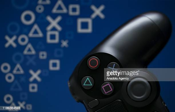Close up detail of analogue control stick and buttons on a Sony Play Station controller is seen in Ankara, Turkey on December 03, 2019.