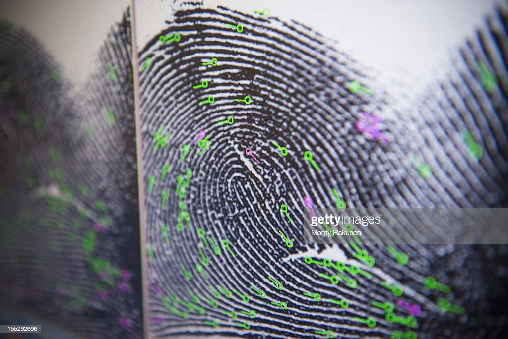 Close up detail of fingerprint on screen in forensic laboratory : Stock Photo