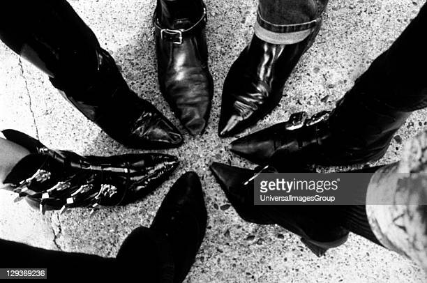 Close up detail of pointy black boots together in a circle at Goth weekend at Whitby UK 1990's