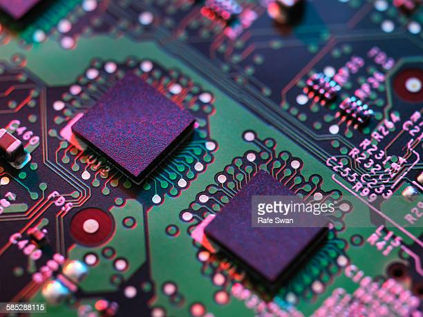 Close up detail of purple and green computer circuit board