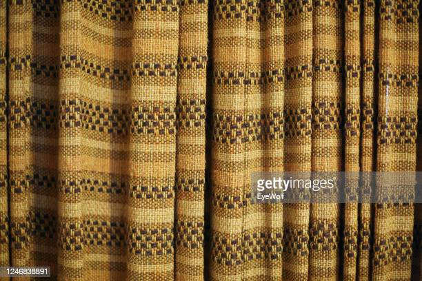 close up detail shot of old curtains in a house from the seventies. - キャメル色 ストックフォトと画像