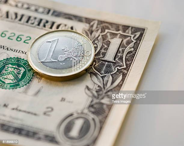 Close up euro coin and us dollar