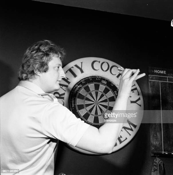 Close up feature on British darts player Eric Bristow in dart throwing action 31st January 1985