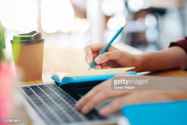 close up female hands with pen writing on notebook. - journalist stock pictures, royalty-free photos & images