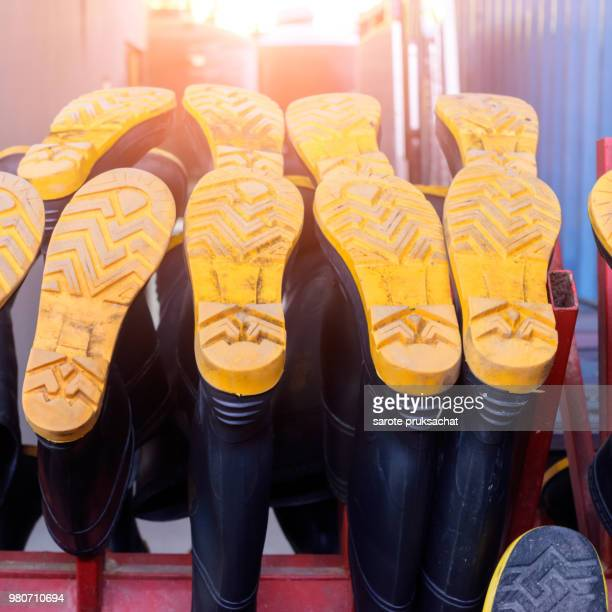 Close up Fireman footwear in fire station .Rubber product .