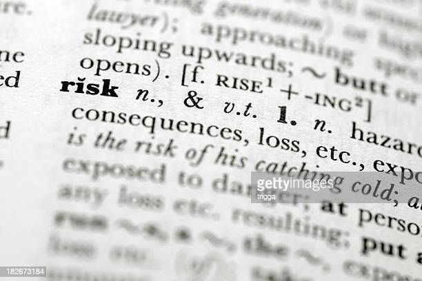 A close up focused on the definition of risk in a book